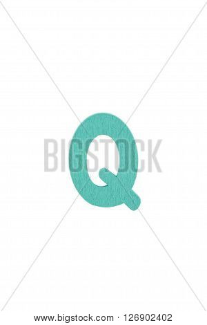 Q capital letter - green color alphabet made from wood isolated on white background