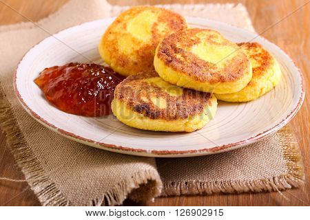 Cornmeal and cottage cheese fritters on plate