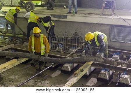 Underground Subway Tunnel Workers Pouring Concrete