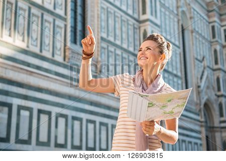 Happy Woman Tourist With Map Pointing On Something Near Duomo
