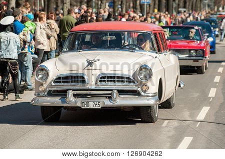 NORRKOPING, SWEDEN - MAY 1: Chrysler Town & Country Wagon 1955 at classic car parade celebrates spring on May 1, 2013 in Norrkoping, Sweden. This parade is an annual tradition in Norrkoping on May Day.