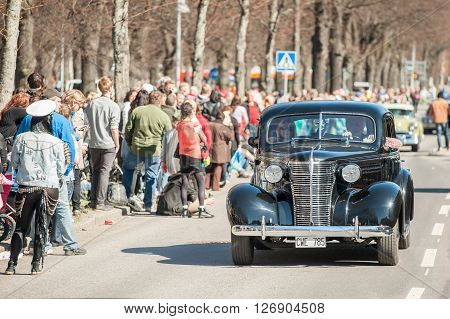 NORRKOPING, SWEDEN - MAY 1: Classic car parade celebrates spring on May 1, 2013 in Norrkoping, Sweden. This parade is an annual tradition in Norrkoping on May Day.