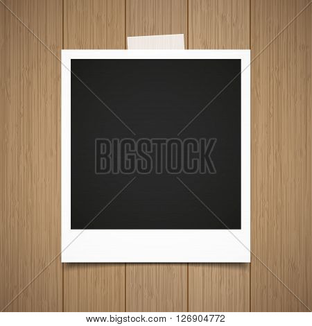 Photo frame stick on vintage wooden texture. Vector illustration.