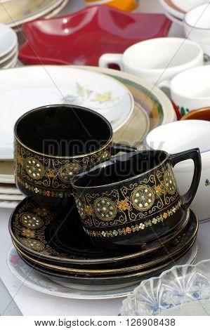 Coffee mugs black group objects still life.
