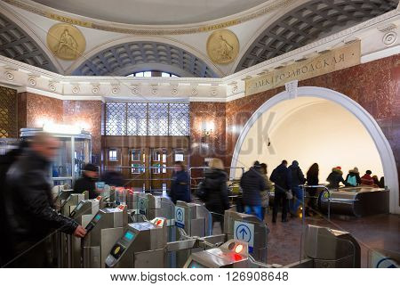 MOSCOW - MARCH 3: People passing through the turnstiles in lobby of the Electrozavodskaya subway station on March 3 2016 in Moscow. The station's hexagonal shaped vestibule features a domed structure on a low drum.