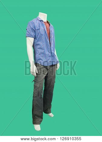 Male mannequin dressed in casual clothes. Isolated on green background. No brand names or copyright objects.