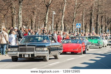 NORRKOPING, SWEDEN - MAY 1: Cadillac Sedan De Ville 1975 at classic car parade celebrates spring on May 1, 2013 in Norrkoping, Sweden. This parade is an annual tradition in Norrkoping on May Day.
