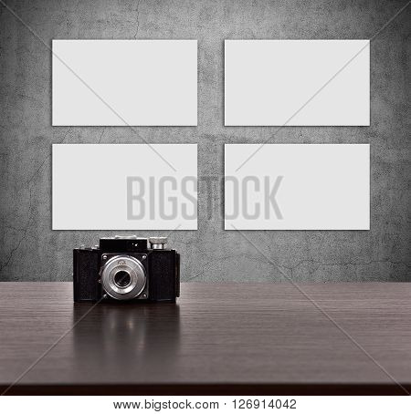 Four Blank Picture On Concrete Wall