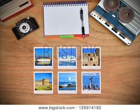 Old retro reel tape recorder vintage radio retro camera on wooden table. Six travel foto card.
