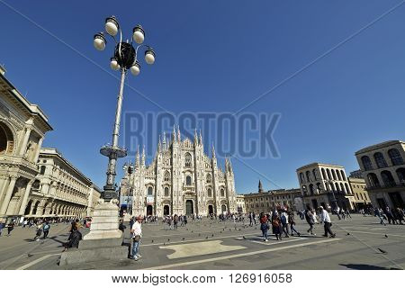 Milano - April 19, 2016: Tourists in Piazza Duomo in the year of