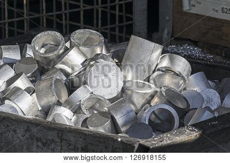 A heap of Aluminum scraps in a container