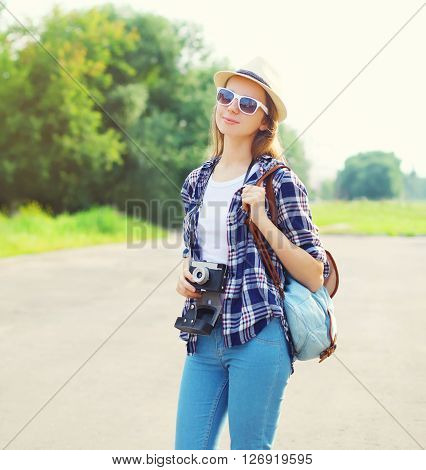 Portrait Of Pretty Woman Wearing Straw Hat Sunglasses And Vintage Camera