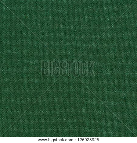 Grass green wool knitted fabric texture. Close up fragment of the top view.