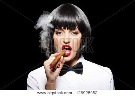 Sexy mafiosi woman smoke with cigar isolated on black