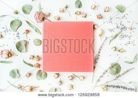 pink wedding or family photo album roses lavender branches leaves and petals isolated on white background. flat lay overhead view
