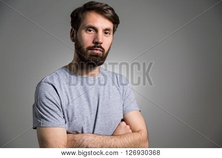 Crossed Arms Light Grey Background