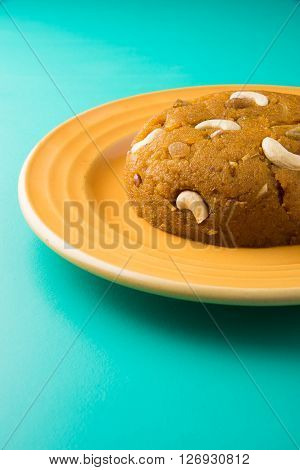 Moong Dal Halwa - a sweet dish from India, Indan Sweet Halwa made from Moong Dal, moong dal sweet sheera or shira cooked in pure ghee, served in a yellow ceramic plate