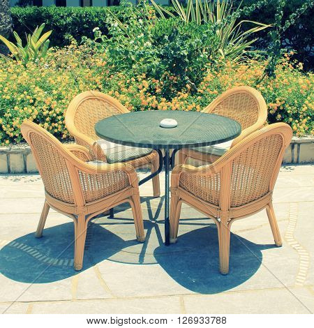 wicker seats on the mediterranean hotel terrace, Crete, Greece. square toned image