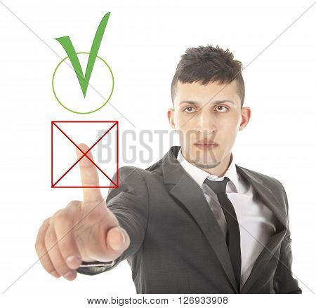 Young businessman choosing no over yes isolated on white background