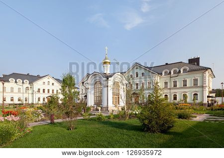 Orthodox temple complex. The chaptel. Architectural lighting. Internal territory of the complex. Street lamp in classic style chapel and bell tower. Sidewalks and landscaping