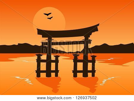 Japanese temple gate silhouette on the lake at sunset