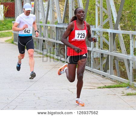 PILSEN, CZECH REPUBLIC - APRIL 23, 2016: Two runners on Plzensky pulmaraton (half marathon) run. Most popular international sport event in Western Bohemia.