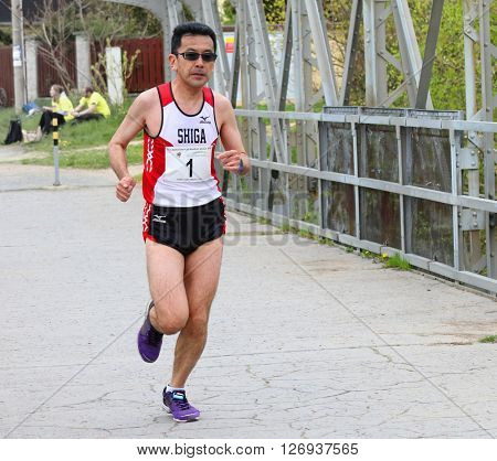 PILSEN CZECH REPUBLIC - APRIL 23, 2016: Nobuyuki Yamaguchi from Daikin Team winner of Plzensky pulmaraton (half marathon) run. Most popular international sport event in Western Bohemia.