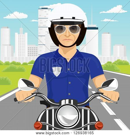 portrait of confident policeman with sunglasses riding motorcycle through the city streets