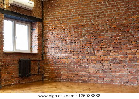 Room With A Window, Red Brick Walls And Wooden Flooring Of Boards