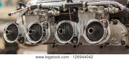 Four air in takes of a twin carburetor
