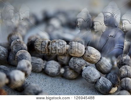 Weathered Prayer Beads with Meditating Buddha Spirit Guides concept photograph