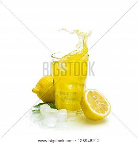 Lemon drink with ice on white background. Fruit cocktail splash