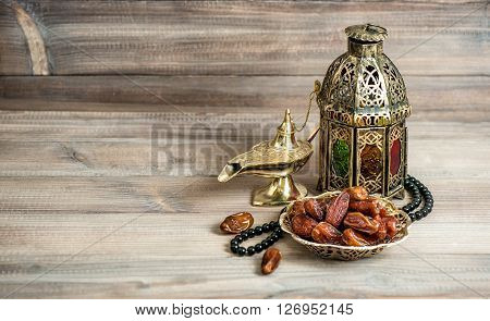 Arabian lantern dates and rosary. Islamic holidays concept. Ramadan decoration