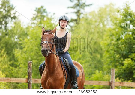 Active woman girl jockey training riding horse. Equestrian sport competition and activity.