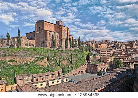 The medieval church Basilica of San Domenico on the hill above source Fontebranda in the ancient town Siena in Tuscanym Italy