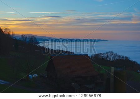 Rorschacherberg, Switzerland, December 20, 2015: The sea of fog at sunset covers Lake Constance, seen from Rorschacherberg, Switzerland