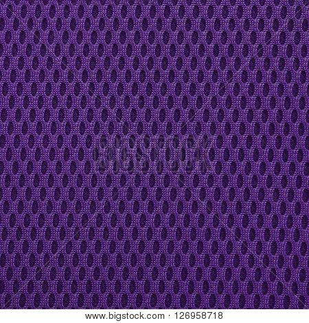 Medium purple multilayer fiber fabric texture. Close up top view.