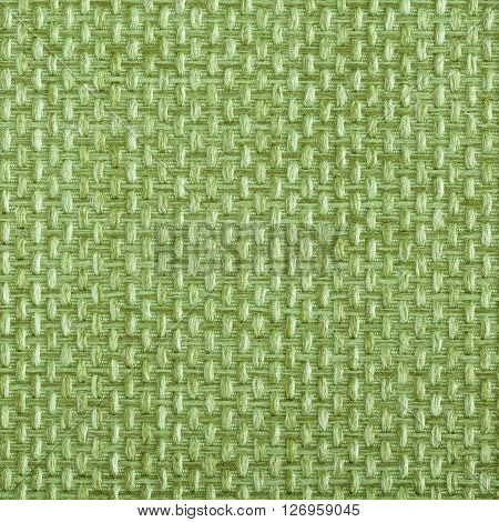 Yellow green fabric texture. Close up top view.