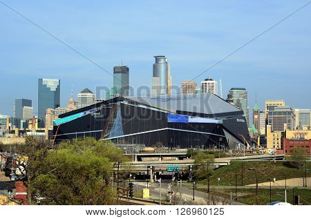 MINNEAPOLIS MN - APRIL 23 2016: Minnesota Vikings US Bank Stadium in Minneapolis with Downtown Skyline