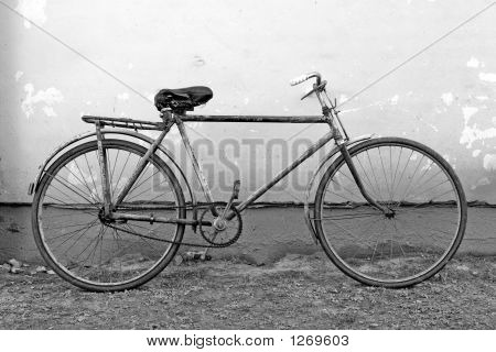 Old Bicycle Leaning Against A