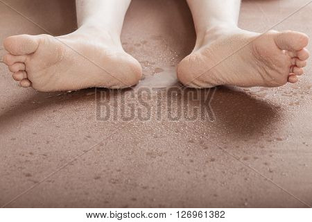 Soles Of Dirty Feet On Ground