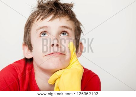 Thinking Child With Rubber Gloved Finger On Chin