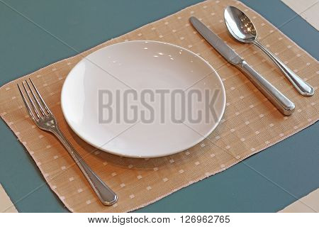 Spoon Fork  Knife And Empty White Plate