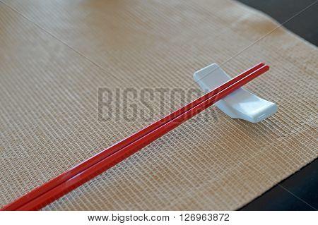 Red Chopsticks And Chopsticks Rest