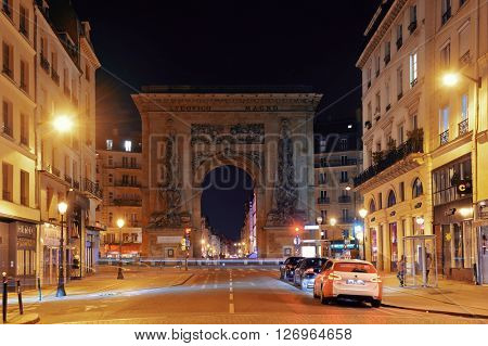 PARIS, FRANCE - MAY 13: street view at night on May 13, 2015 in Paris. With the population of 2M, Paris is the capital and most-populous city of France
