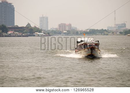 BANGKOK THAILAND-APRIL 23 : A passenger ship convoys people on Choa Phaya River April 23 2016 in BangkokThailand.