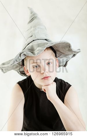 Serious Boy Wearing Gray Pointed Hat