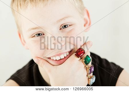Close Up On Happy Boy With Large Rings