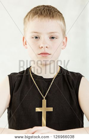Serious Child Wearing Golden Crucifix