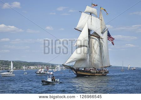 DULUTH MINNESOTA USA - JULY 29 2010: The Pride of Baltimore II a replica of an 1812-era Baltimore Clipper privateer enters Duluth harbor on Lake Superior during the Tall Ships festival.